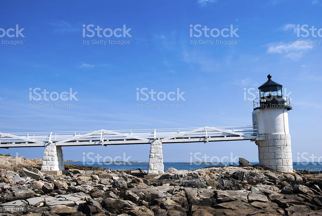Marshall Point Lighthouse with water in background stock photo