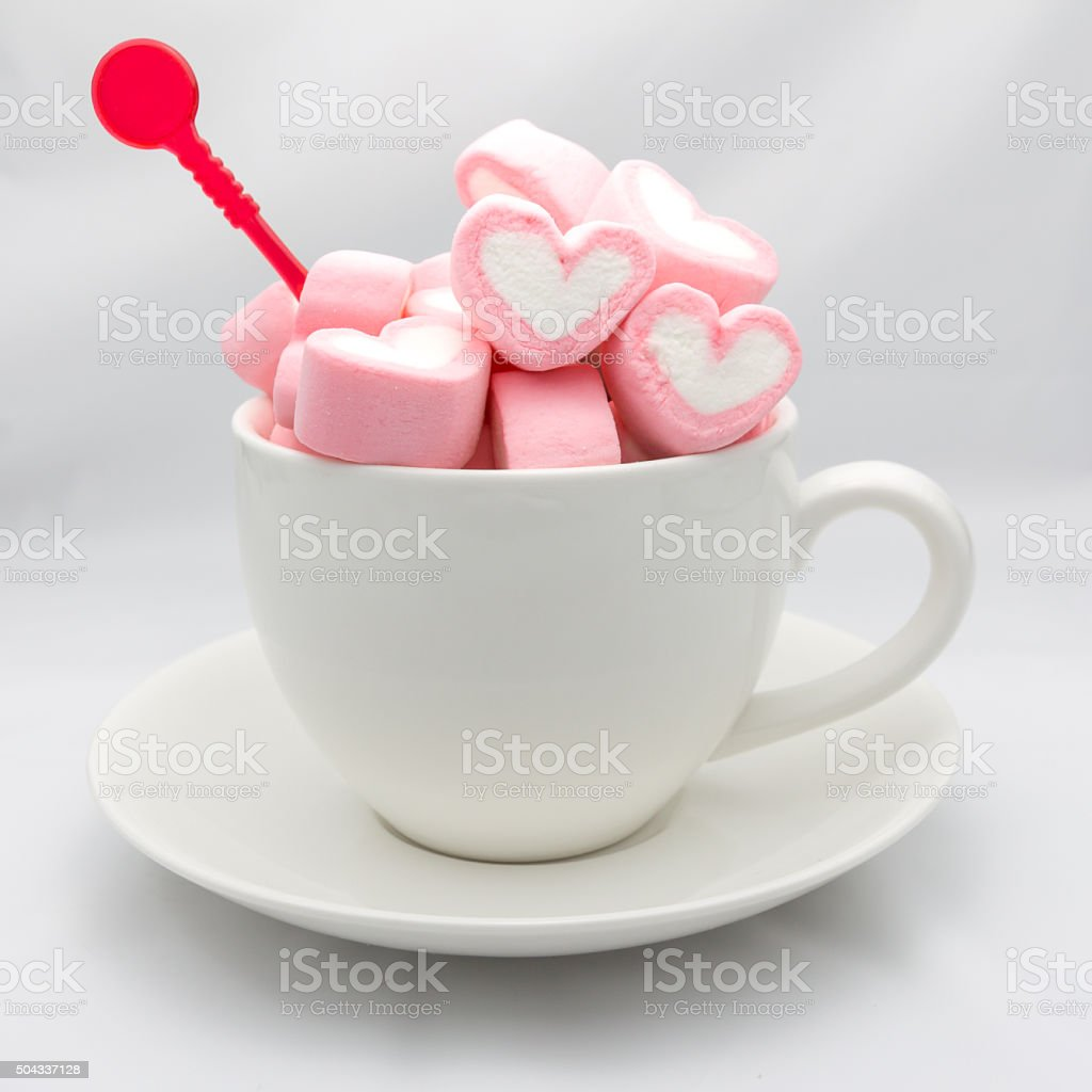 Marshmallow hearts in cup on white stock photo