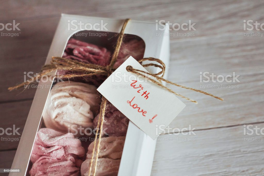 marshmallow in a box on  white wooden background. Delicious swe stock photo