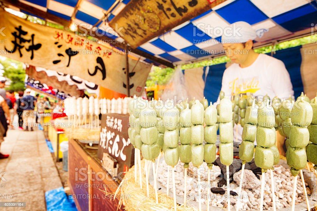Marshmallow merchant at Inari temple Kyoto Japan stock photo