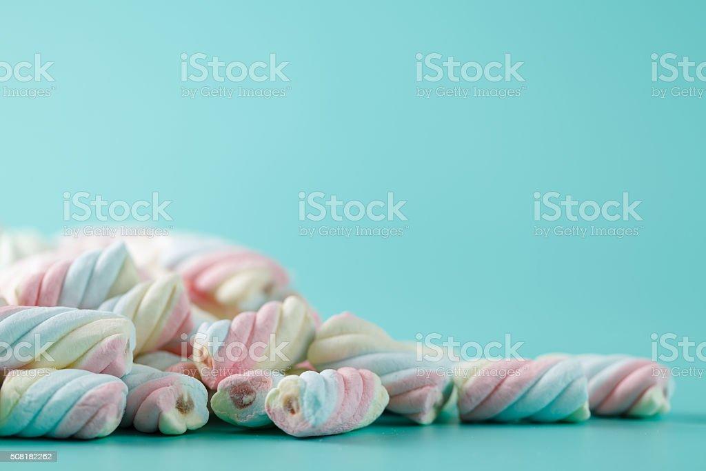 marshmallow on aquamarine backgound stock photo