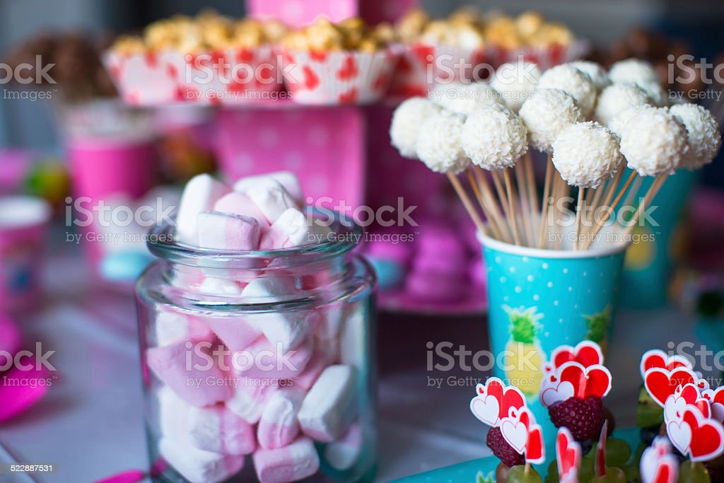 Marshmallow, sweet colored meringues, popcorn, custard cakes and cake pops stock photo
