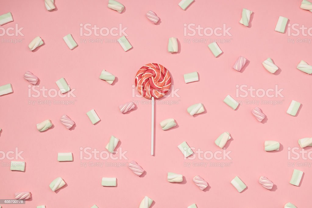 Sweet marshmallows minimalism set with red lollipop on pastel rose...