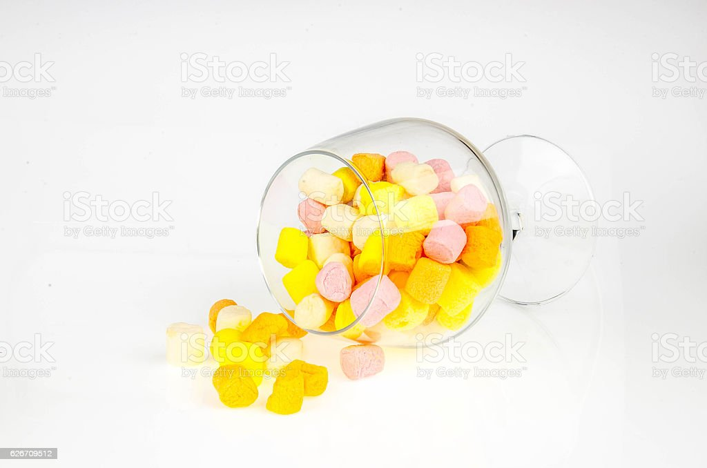marshmallows in beautiful glass on white background stock photo