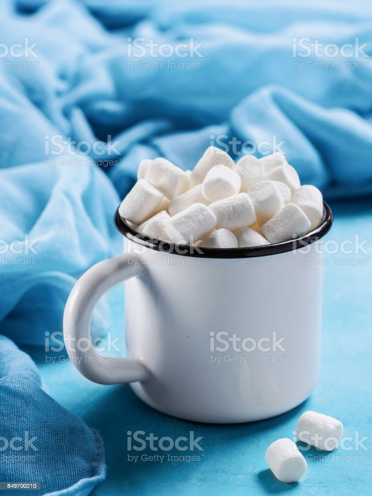 Marshmallows on blue background with copyspace stock photo