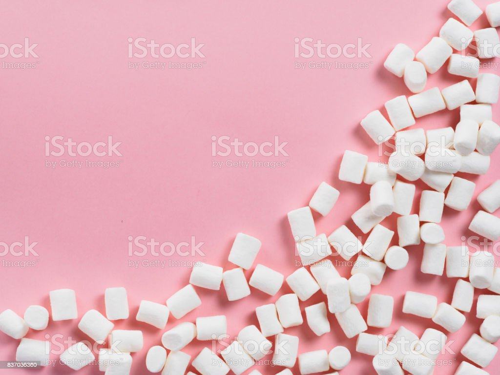 Marshmallows on pink background with copyspace stock photo