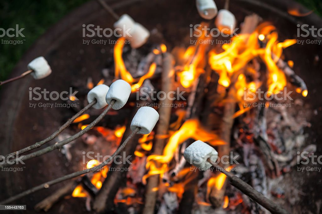 Marshmallows Roasting On An Open Fire Pit stock photo