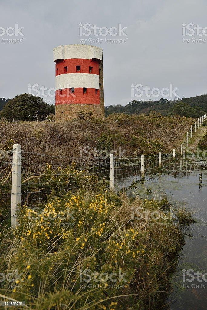 Martello Tower at Ouaisne Bay Jersey. stock photo