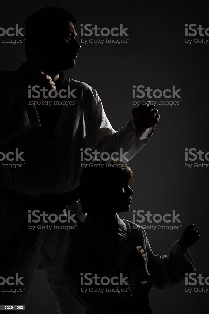 Martial art teacher and student in low light condition stock photo