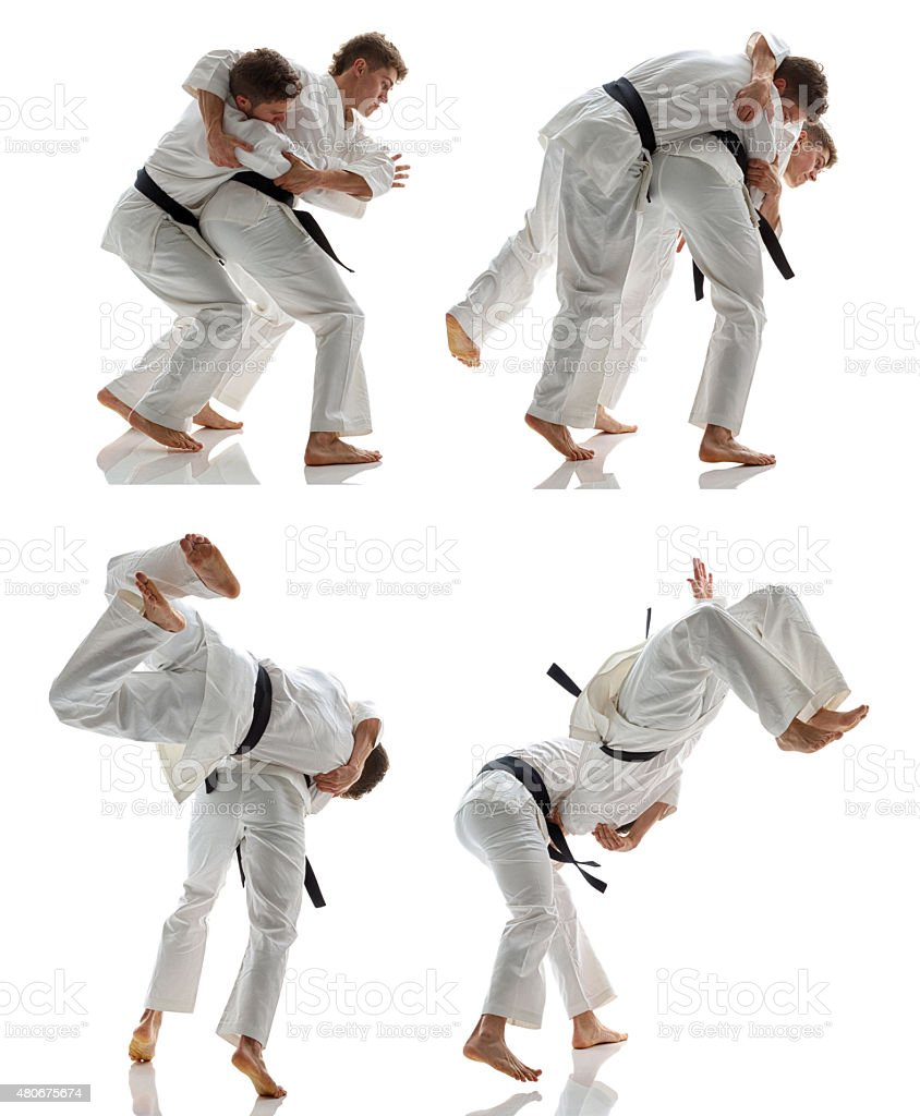 martial artists in action stock photo