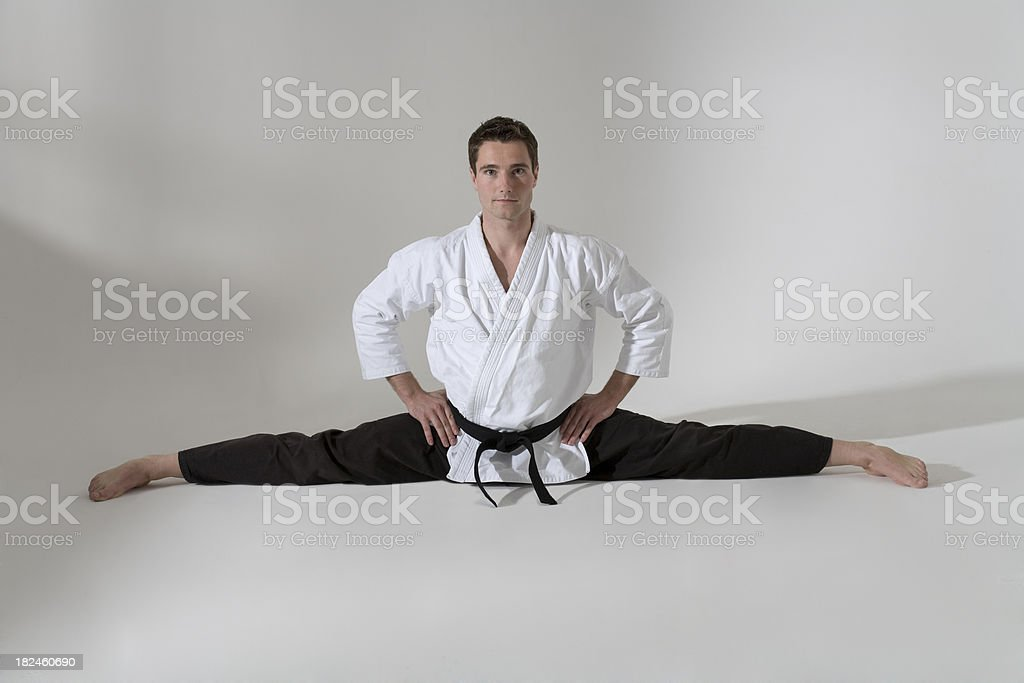 Martial arts artist doing the splits stock photo