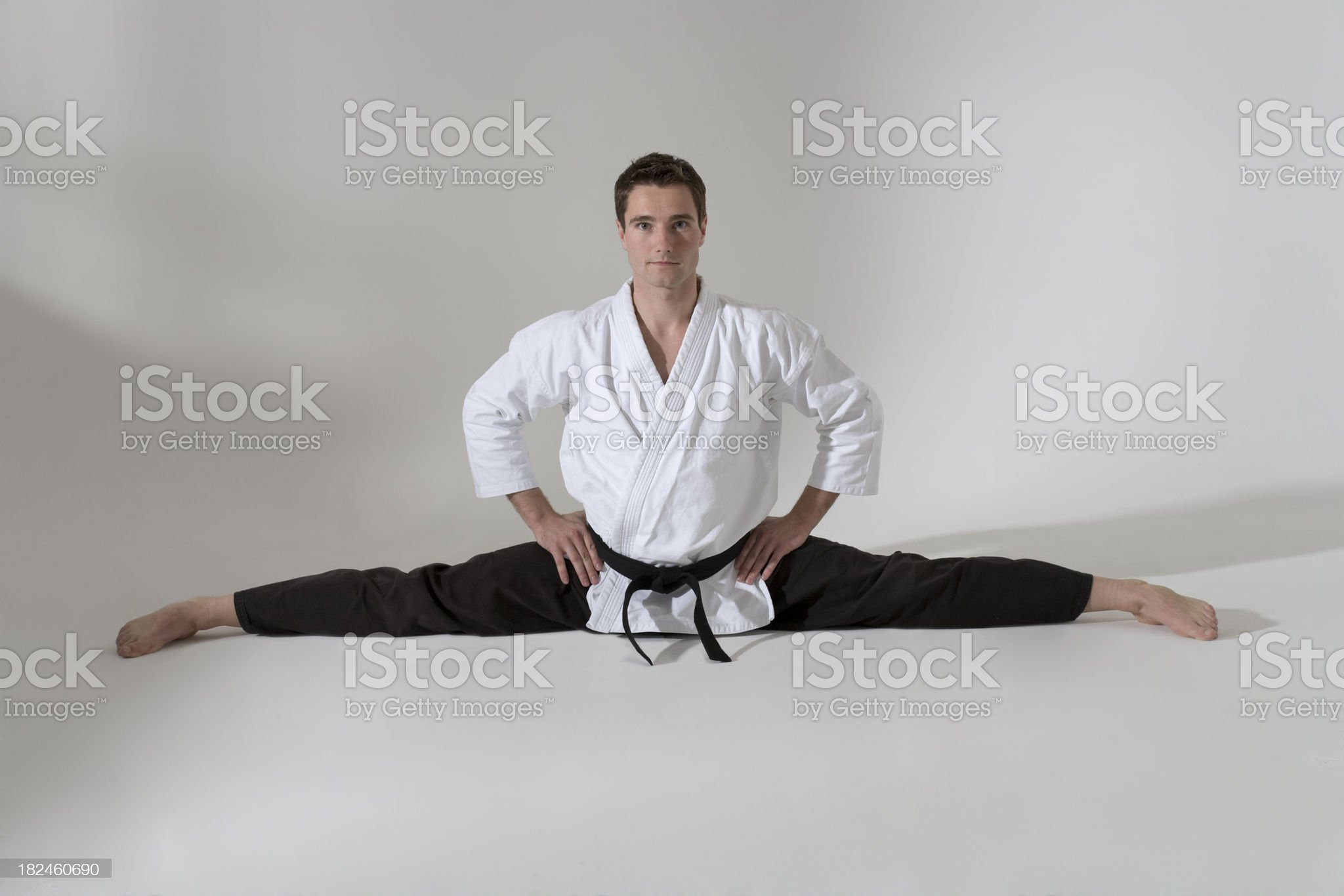 Martial arts artist doing the splits royalty-free stock photo