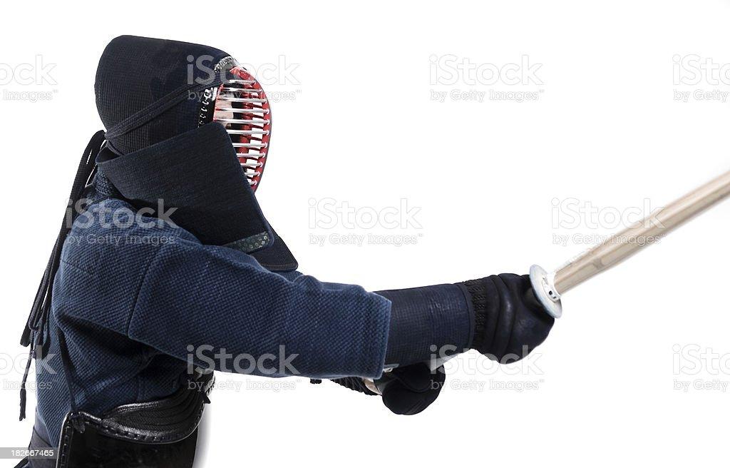 Martial Arts - Kendo sensei attacking with bamboo sword (Shinai) stock photo