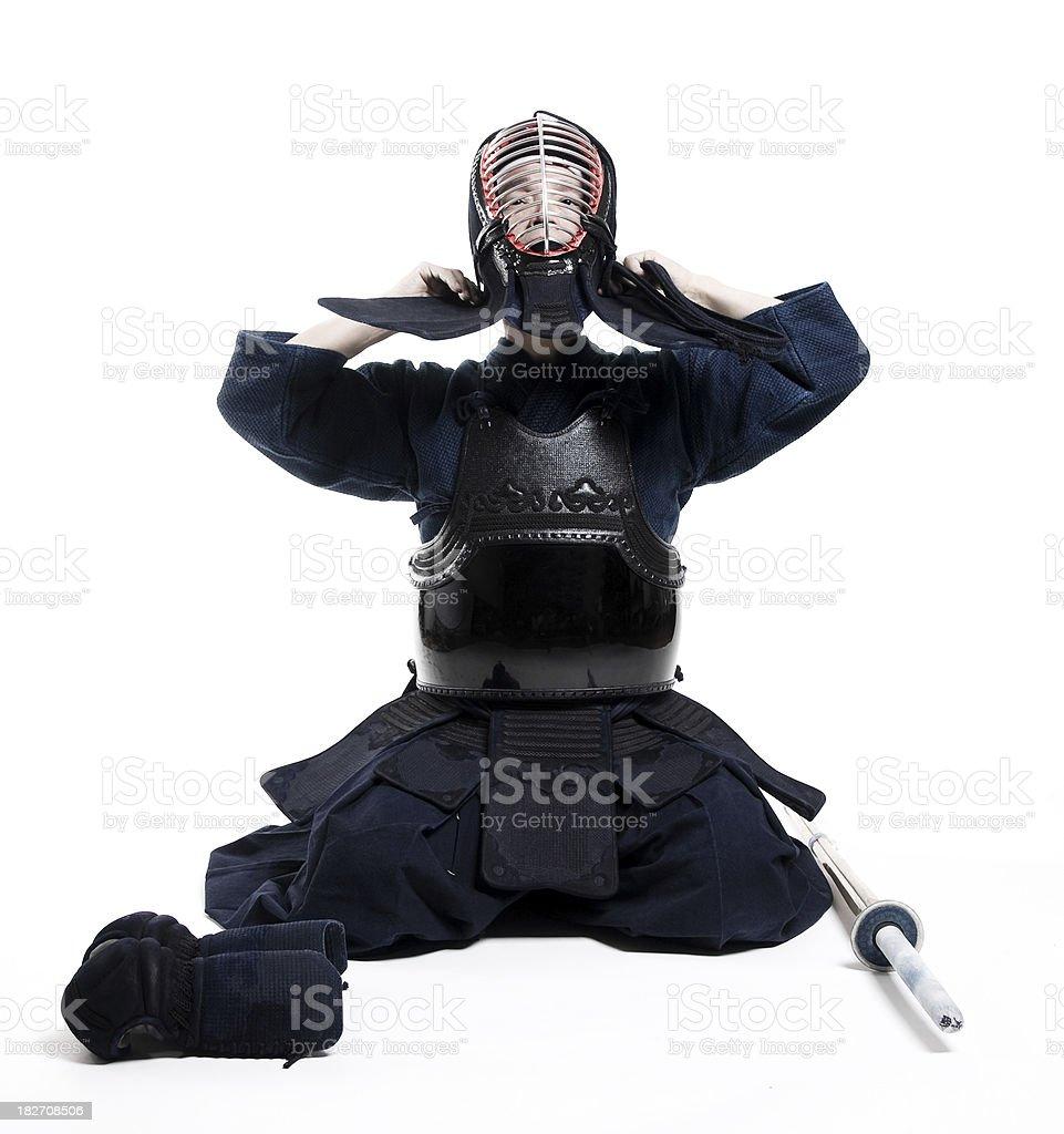 Martial Arts  Kendo sensei taking off uniform with sword (Shinai) stock photo