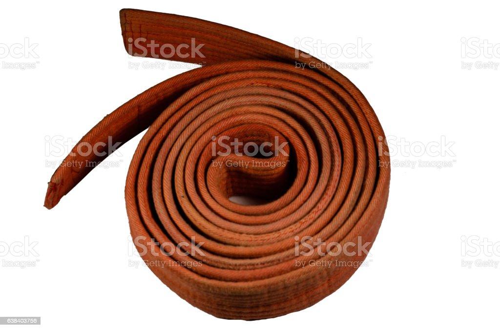 Martial arts orange belt isolated on white stock photo