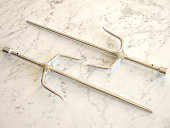 Martial-arts Weapons: Two Chrome-plated Sais on White Marble
