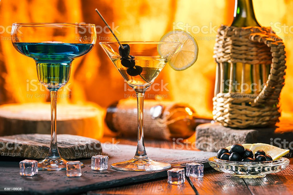 Martini and blue cocktail stock photo
