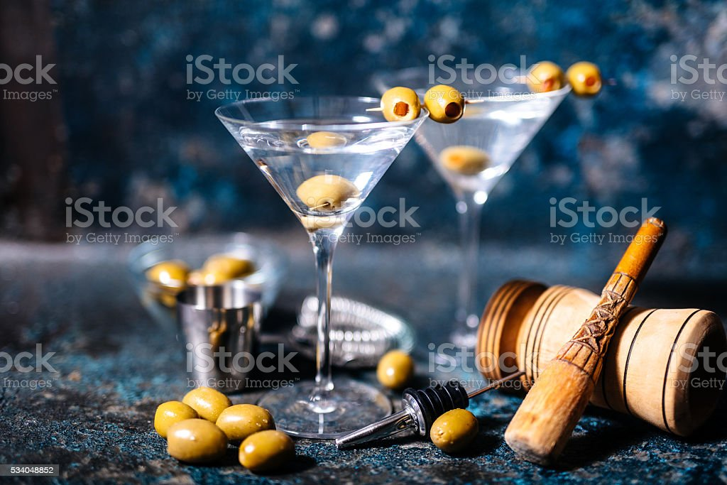 Martini cocktail drink with olives garnish and tools stock photo