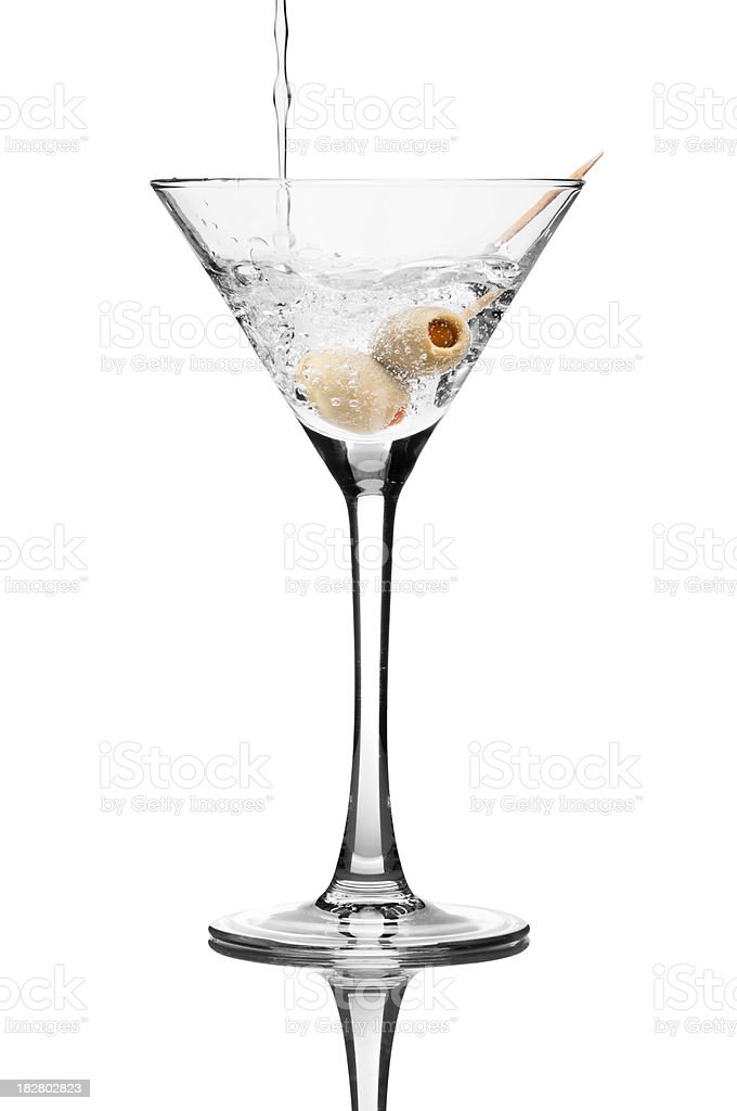 Martini cocktail pouring into martini glass with olives royalty-free stock photo