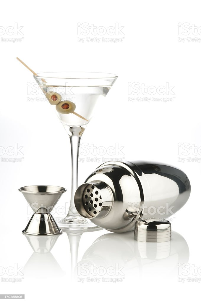 Martini Cocktail, Shaker and Measuring Cup on reflective white backdrop stock photo