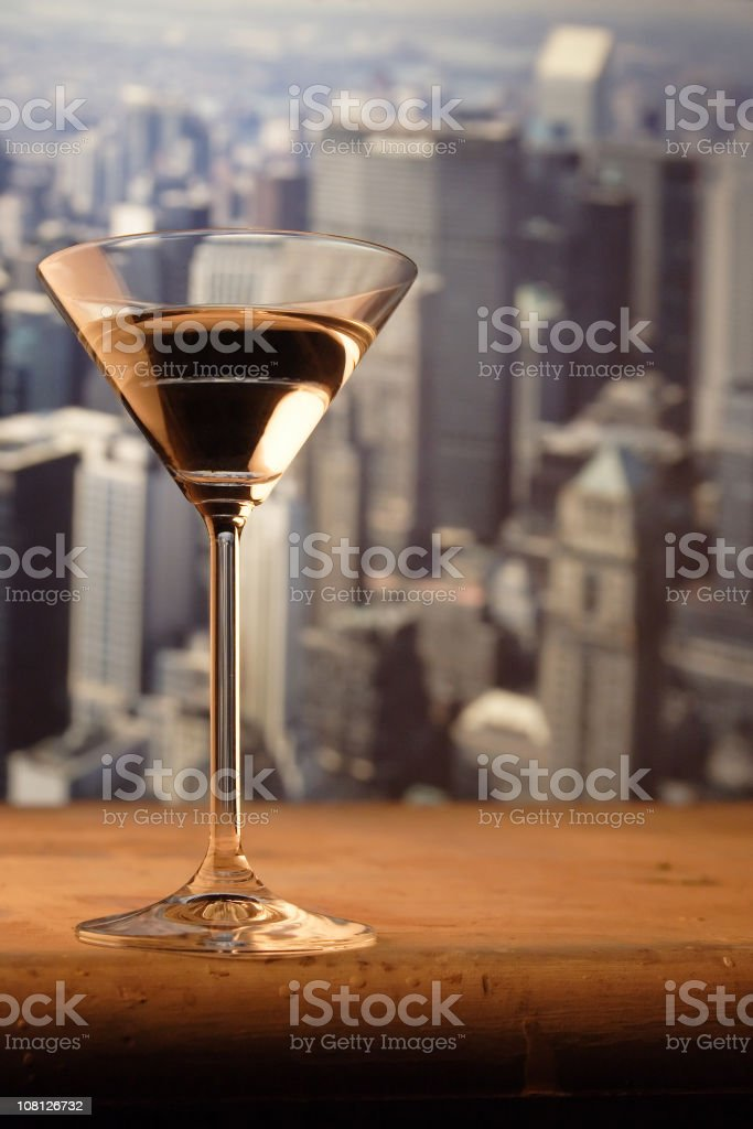Martini Glass on Railing with New York Skyline in Background royalty-free stock photo