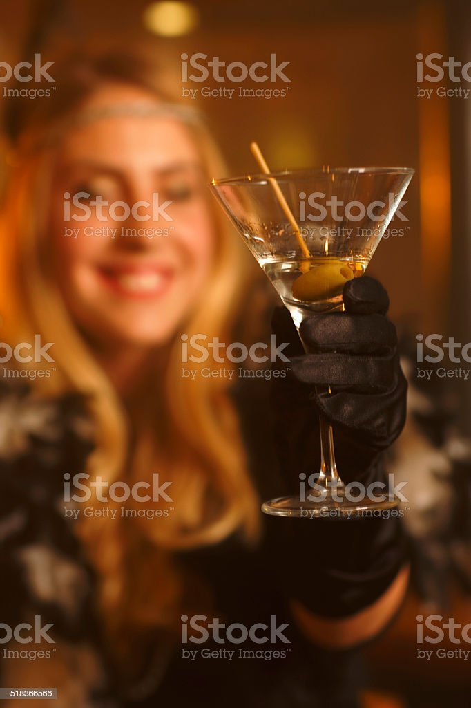 Martini Glass   Retro  Old-fashioned woman drinking dry martini stock photo