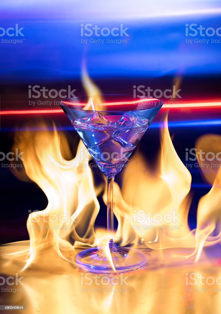 Martini glass with fire stock photo
