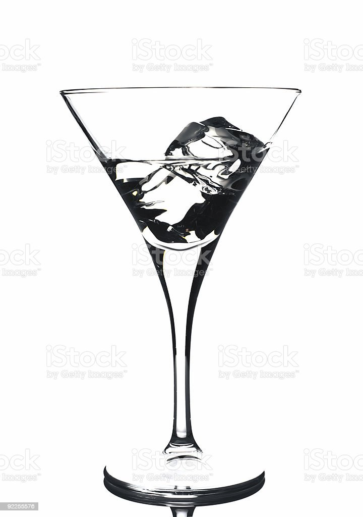 martini glass with ice cubes and some drink royalty-free stock photo