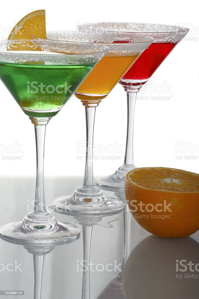 martini glass with multicolor cocktails and piece of citrus 3 royalty-free stock photo