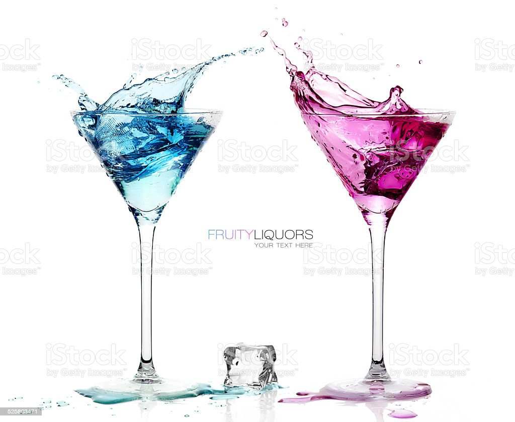 Martini Glasses with Splashing Fruity Cocktails. Template design stock photo