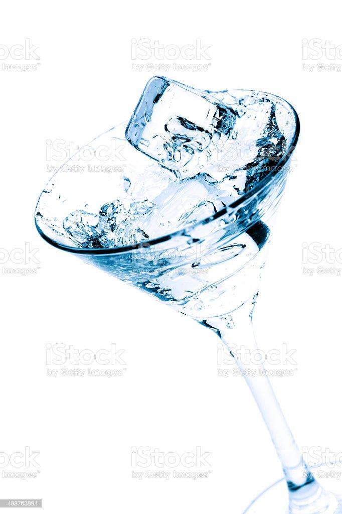 Martini splash isolated on white stock photo