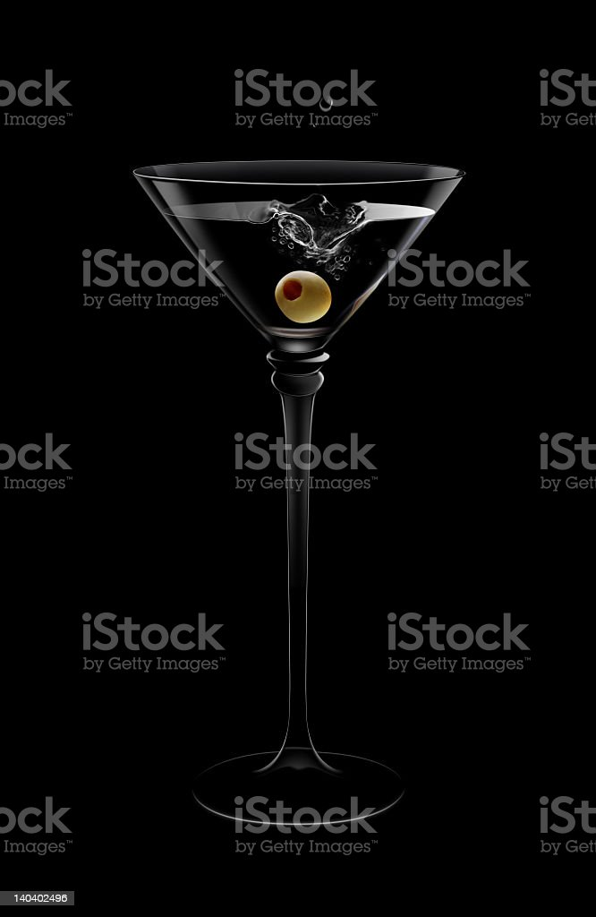 A martini with an olive dropped in with a black background royalty-free stock photo