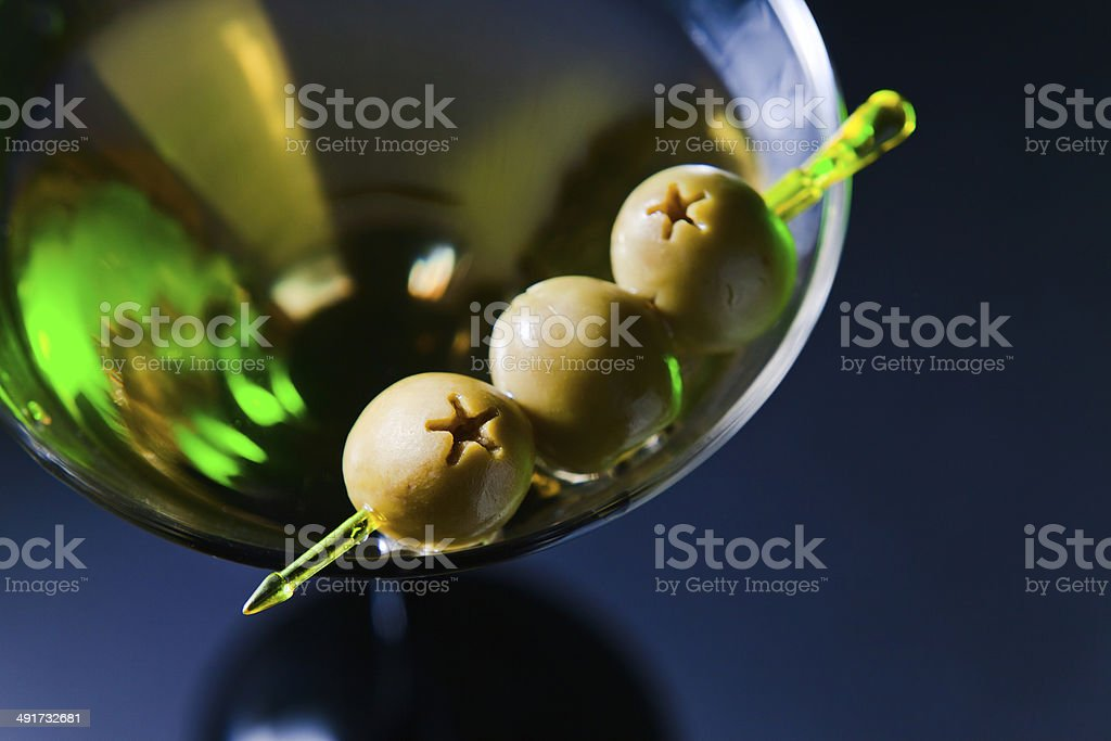 martini with green olives stock photo