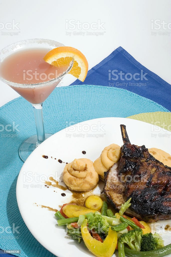 Martini with Grilled Pork Chop Dinner stock photo