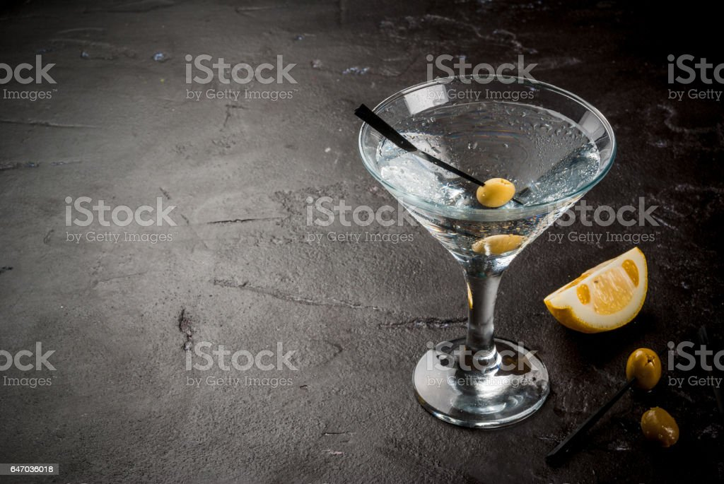 Martini with olives and a lemon stock photo
