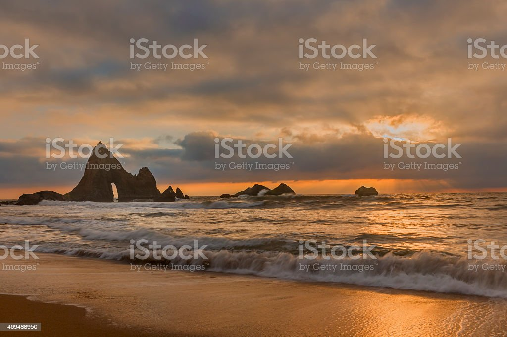 Martins beach near half moon bay at sunset stock photo