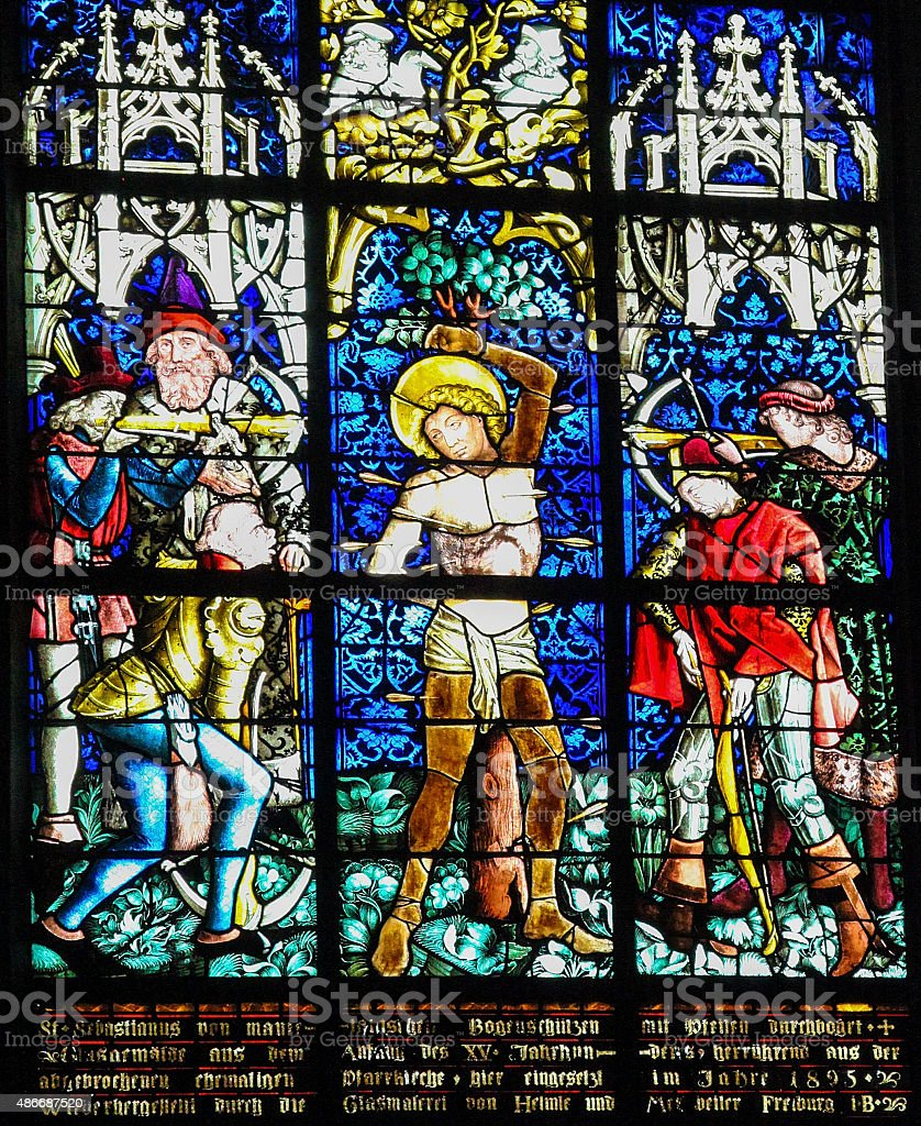 Martyrdom of Saint Sebastian - Stained Glass in Obernai stock photo