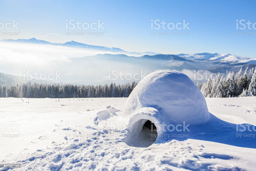 Marvelous huge white snowy hut, igloo  the house of isolated tourist is standing on high mountain far away from the human eye. stock photo