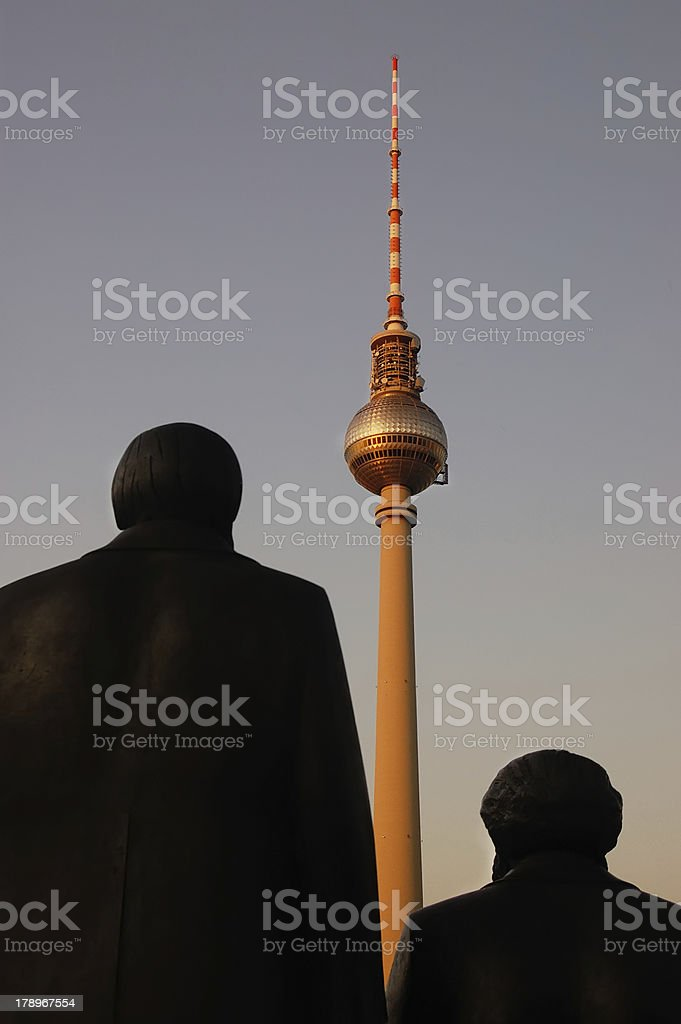 Marx and Engels States looking at Berlin TV Tower (Fernsehturm) stock photo