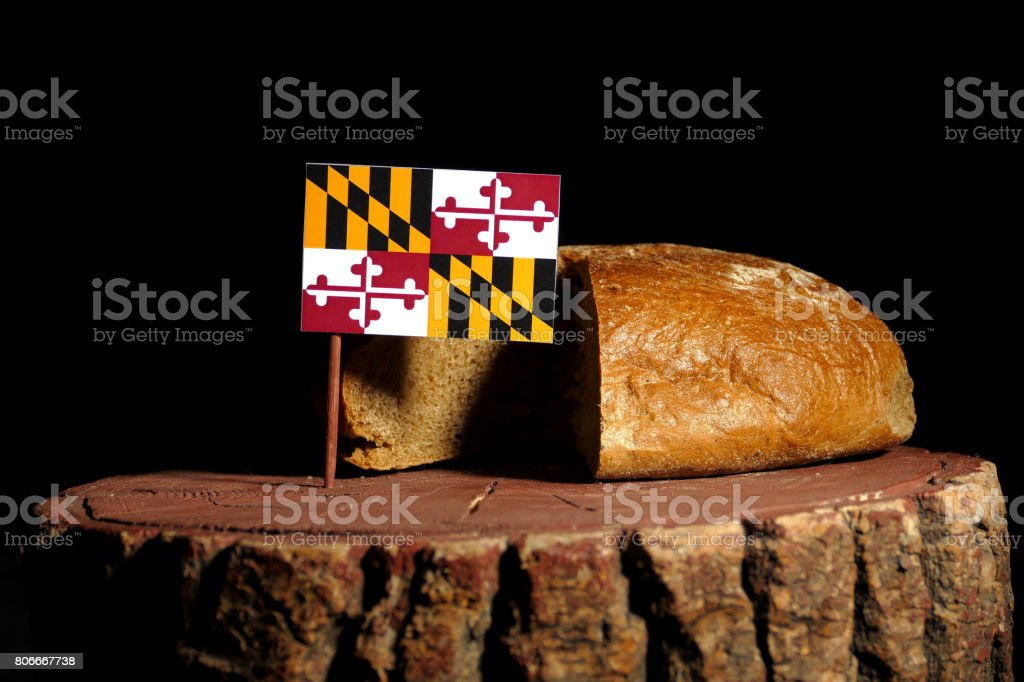 Maryland flag on a stump with bread isolated stock photo
