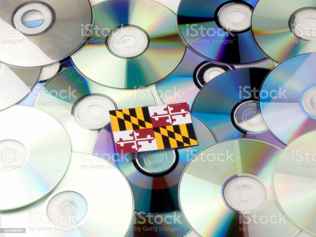 Maryland flag on top of CD and DVD pile isolated on white stock photo