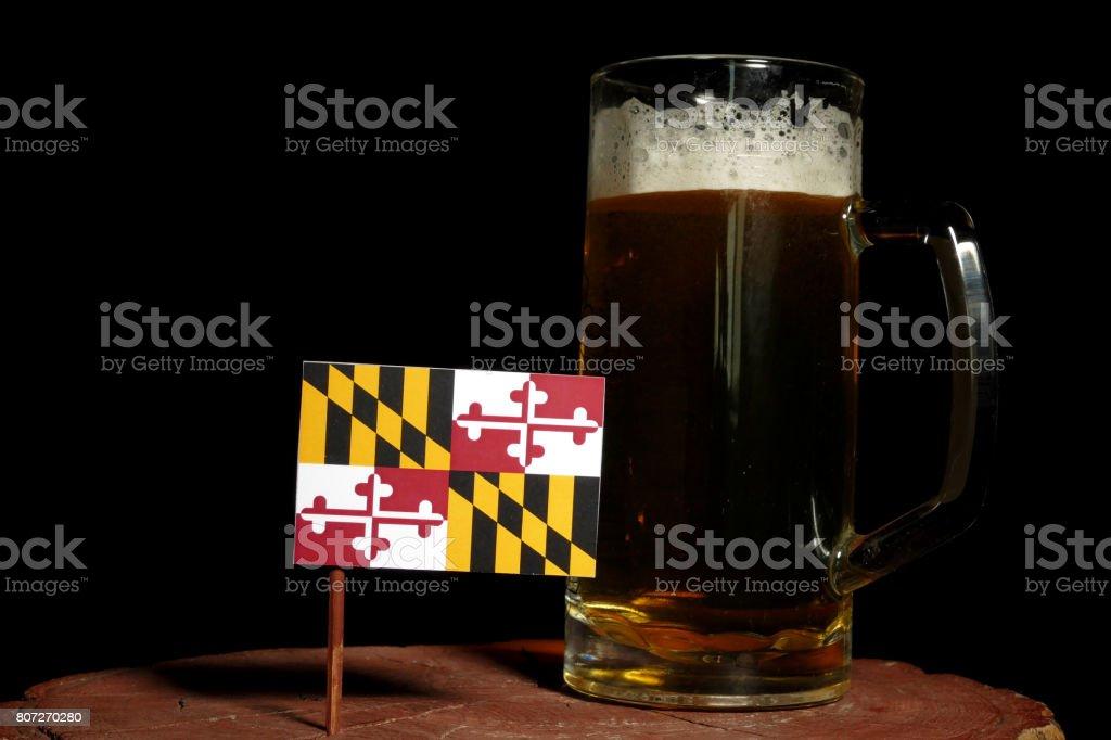 Maryland flag with beer mug isolated on black background stock photo