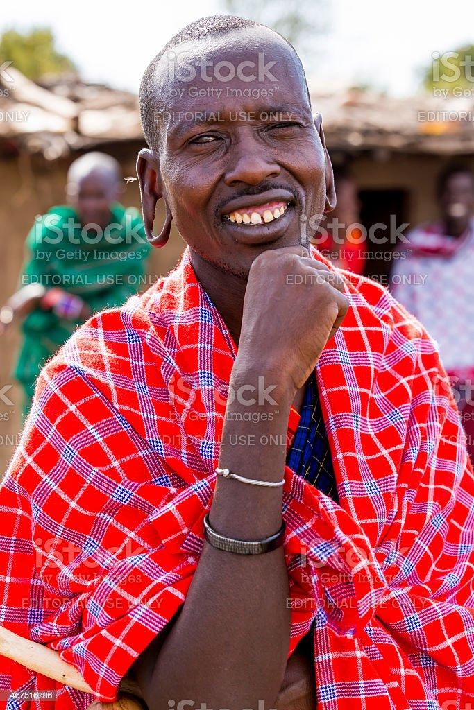 Masai Mara, Kenya: African man with fly stock photo