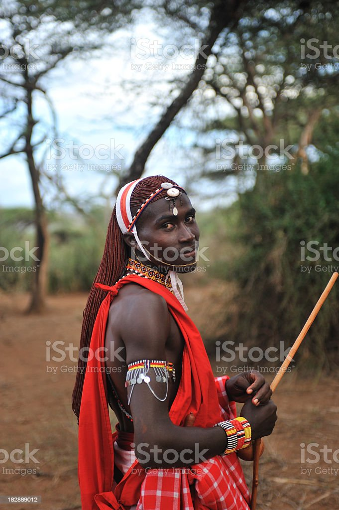 Masai outdoors in traditional clothing stock photo