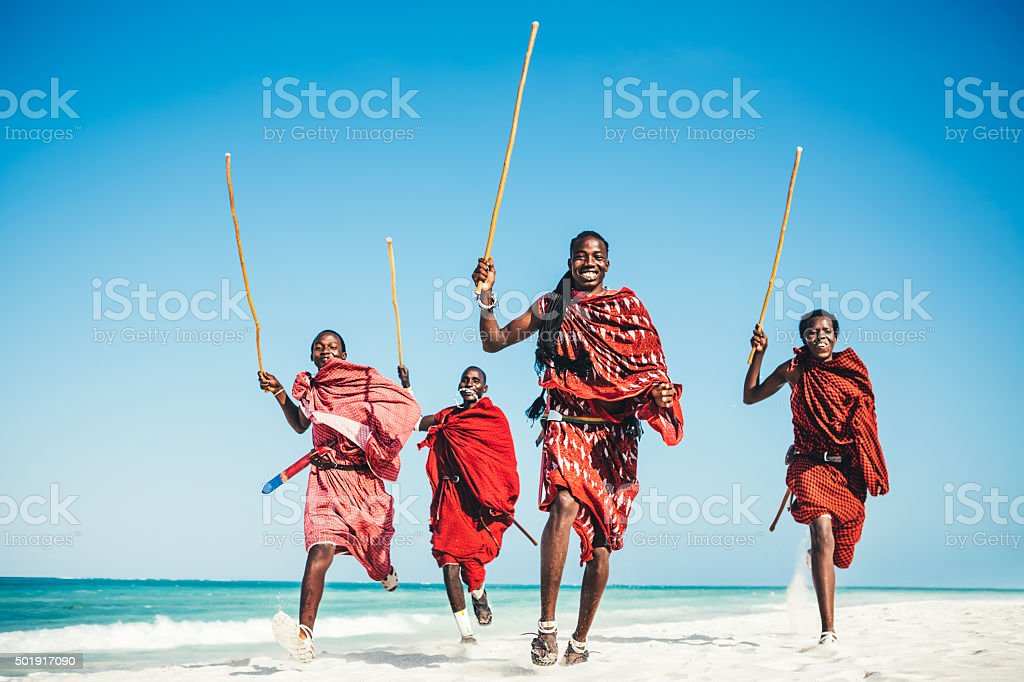 Masai People Running On The Beach.jpg stock photo
