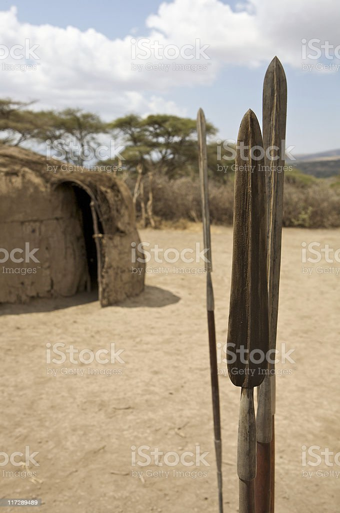 Masai spears in the ground  left by guests stock photo