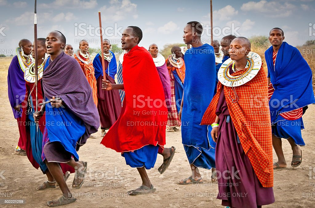 Masai warriors dancing traditional jumps as cultural ceremony, Tanzania. stock photo