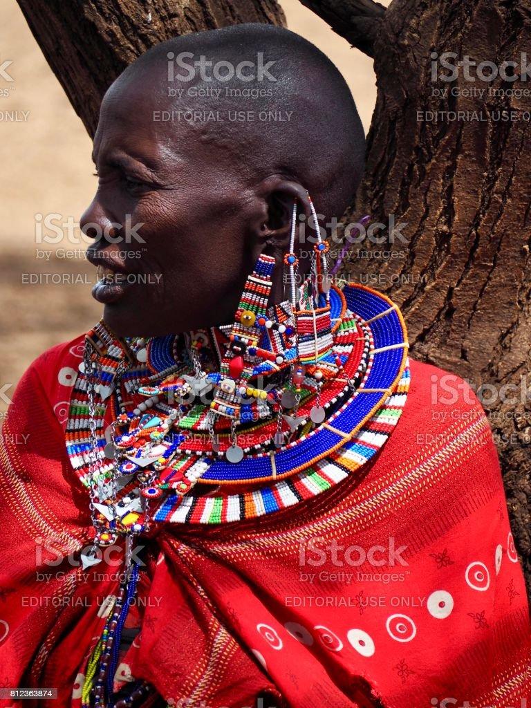 Masai woman sitting under a tree near Amboseli in Kenya stock photo