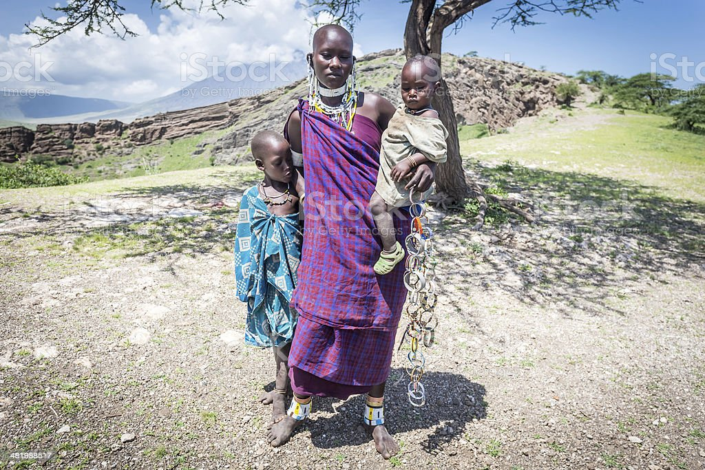 Masai woman with her kids stock photo