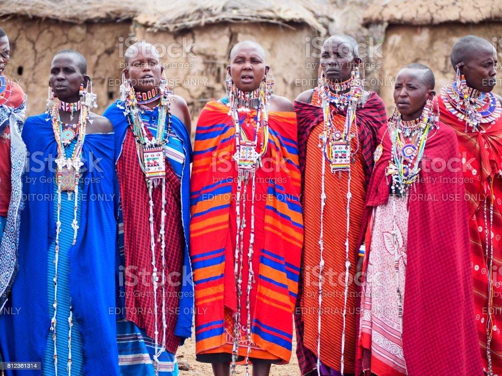 Masai women singing in traditional dress near Amboseli, Kenya stock photo